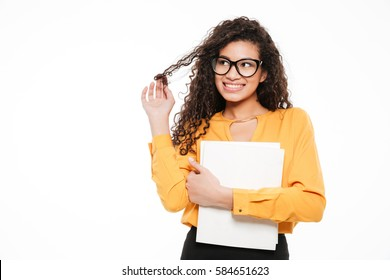 Happy playful african young businesswoman with blank paper sheets over white background