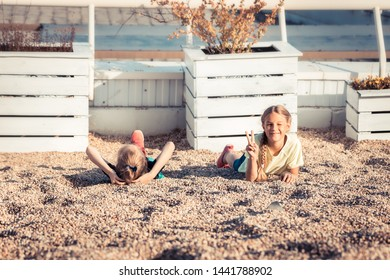 Happy playful children having fun together on summer beach carefree childhood lifestyle