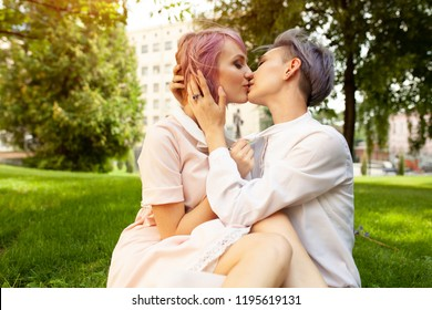 Happy playful lesbian couple in love sharing time together Women friendship concept with girls couple having fun on fashion clothes outdoors Summertime leisure. Friendship concept
