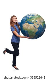 Happy playful woman in full length holding earth globe in her hands, Africa and Europe in front, over white background