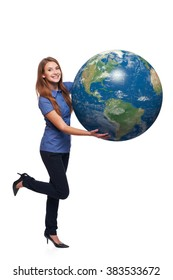 Happy playful woman in full length holding earth globe in her hands, American continent in front, over white background
