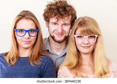 Happy playful young women in glasses. Smiling hipster friends girls and man having fun.