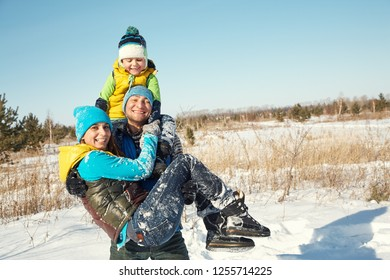 happy playing family in the winter. active people outdoors