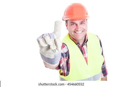 Happy constructor pointing finger or showing number one and smiling isolated on white background