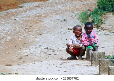 Happy poor african boys - smiling malagasy children