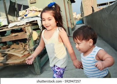 Happy poor latin  siblings