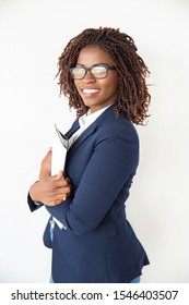 Happy positive accountant holding financial reports, papers, folder. Young African American business woman standing isolated over white background. Successful professional concept