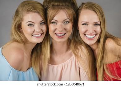 Happy positive female friends having fun enjoying their feminine leisure time. Friendship concept.