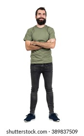 Happy positive man with crossed arms smiling looking at camera. Full body length portrait isolated over white studio background.