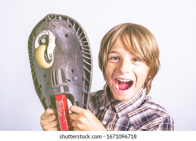 Happy pre teen boy with board. Fun and leisure lifestyle concept.