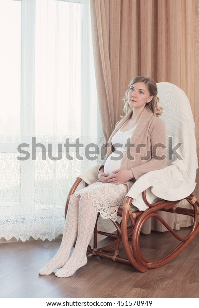 Stupendous Happy Pregnancy Sitting On Rocking Chair Stock Photo Edit Creativecarmelina Interior Chair Design Creativecarmelinacom