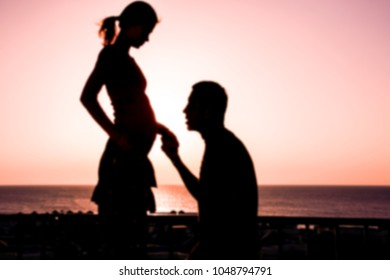 Happy pregnant couple silhouette on nature background coloring