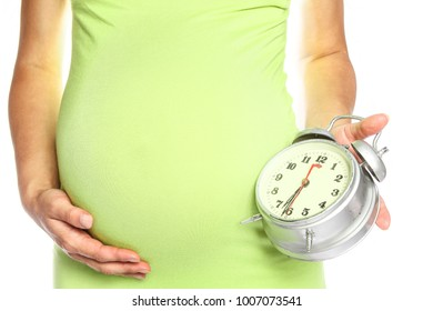 Happy pregnant girl lies on white background