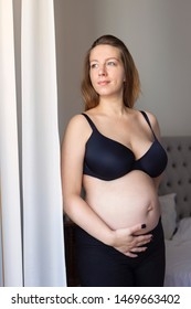 Happy pregnant woman at home