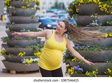 Happy Pregnant Woman Spinning Outdoors