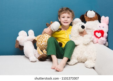 Happy preschool age child play with plush toys