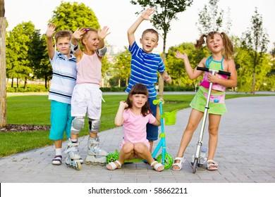 Happy preschool children in a city park
