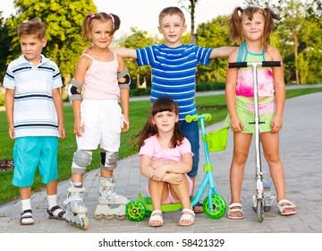 Happy preschool friends in a city park