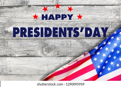 Happy presidents day with flag of the United States on wooden background.