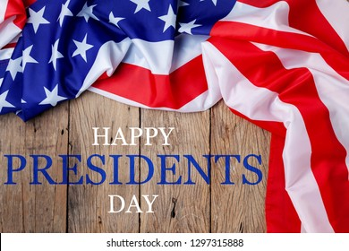 Happy Presidents' Day text on wooden with flag of the United States Border.