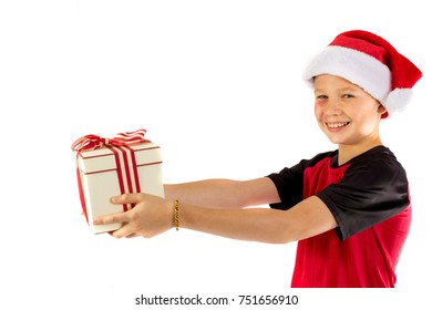 Happy pre-teen boy with a christmas gift isolated on white background