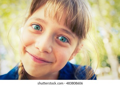 Happy pretty blonde girl walking in the park. Vignetting,
