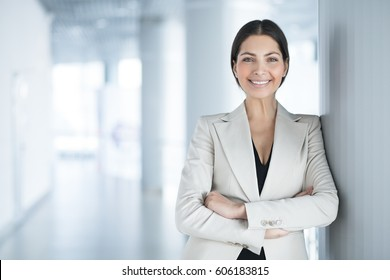 Happy Pretty Business Woman Standing in Hall