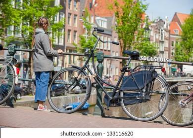 Happy pretty girl walking outdoors in Amsterdam