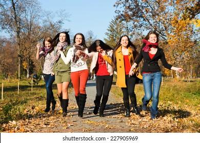 Happy pretty girls in the park