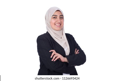 Happy pretty Muslim girl with arms crossed, isolated on a white background.