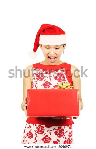 A happy pretty woman receiving a present