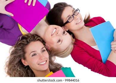 Happy pretty women with exercise books lying together in line