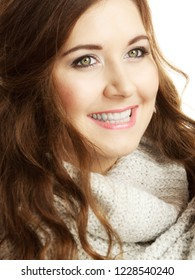 Happy pretty young woman with curly dark hair wearing soft golf turtleneck light sweater.