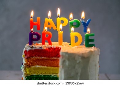 Happy pride day - rainbow layered cake with candles. Tolerance and equality for lgbt community, same sex marriage, copy space