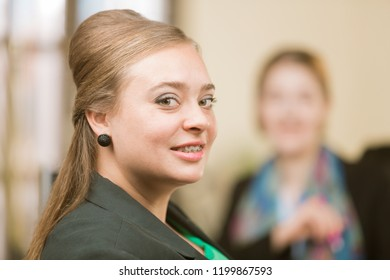 Happy professional woman with braces