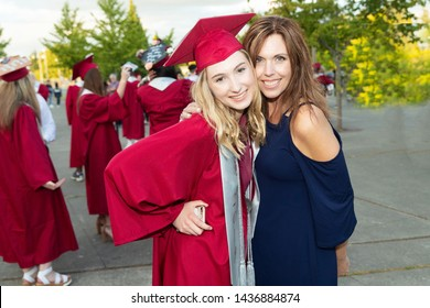 Happy and proud Mother with high school graduate Daughter