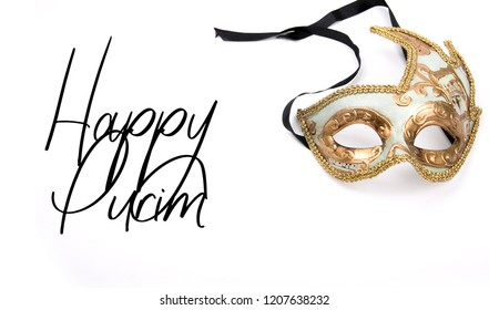 Happy Purim, jewish celebration party invitation (Happy Purim in Hebrew). Carnival mask made of gold glitter, sparkles and calligraphic text.
