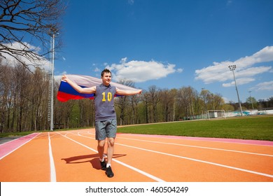 Happy race winner waving Russian flag on the track