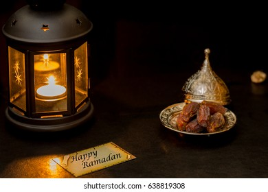 Happy Ramadan  card with lantern and dates in darkness