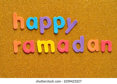 Happy Ramadan on a golden background