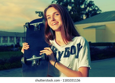 Happy redhair teen with skateboard vintage color toned image