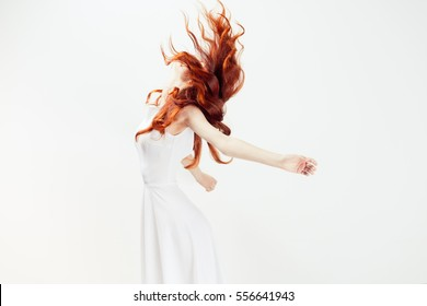 Happy red-haired woman opened her hands with delight and happiness warm colors