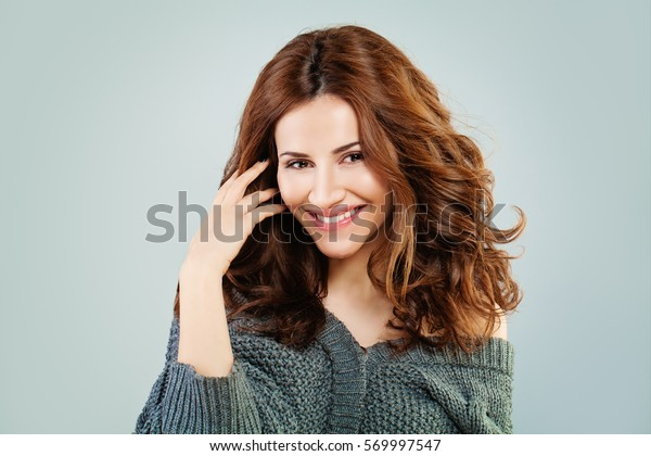 Happy Redhead Woman Smiling. Beautiful Model with Red Curly Hairstyle