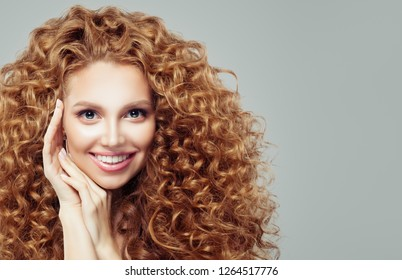 Happy redhead womanwith long curly hair. Emotion. Expressive facial expressions