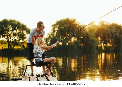 Happy relationship of a couple spending quality time together fishing