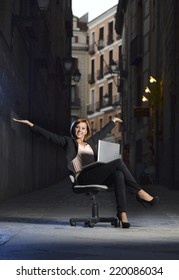 Happy relaxed Business woman office dressed sitting on Chair outdoors on Street with Computer laptop in successful and flexible worker concept on studio lighting