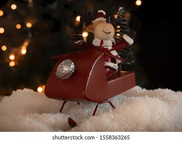 Happy rendeer in a red sled