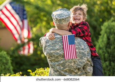 Happy reunion of soldier with family, son hug father with american flag