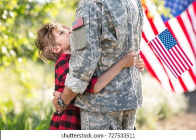 Happy reunion of soldier with family/ tender scene father and son hugging