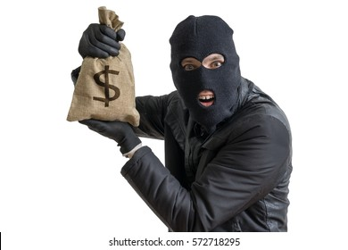 Happy robber is showing stolen bag full of money. Isolated on white background.